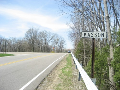 Sign  greeting travelers to the old town of Kasson along New Harmony Rd